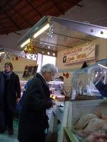 jackie buying duck at luçon farmers market
